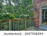 backyard garden of custom built ... | Shutterstock . vector #1047528394