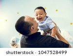 hapiness and beatiful family | Shutterstock . vector #1047528499