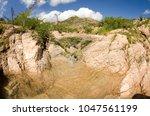 desert creeks  mexico. | Shutterstock . vector #1047561199