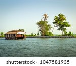 Small photo of ALLEPPEY, INDIA -DEC 17: Tourists enjoying house Boat cruise in back waters, tropical forests of Kerala India on Dec. 2011. One of the major tourist attraction in south India.