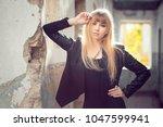 blonde in a black jacket... | Shutterstock . vector #1047599941