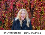 happy smiling blond with leaves ... | Shutterstock . vector #1047603481