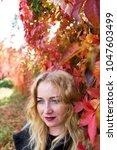 sad blond woman is standing... | Shutterstock . vector #1047603499
