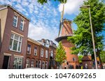 traditional old mill and houses ... | Shutterstock . vector #1047609265
