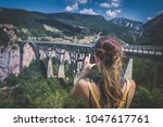 young woman tourist taking... | Shutterstock . vector #1047617761
