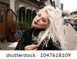 bright young blond woman in a... | Shutterstock . vector #1047618109