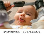 a nine month old baby with a... | Shutterstock . vector #1047618271