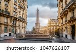 small paris street with view on ... | Shutterstock . vector #1047626107
