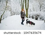 red haired girl walking at park ... | Shutterstock . vector #1047635674