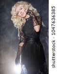 luxurious blonde with a fluffy... | Shutterstock . vector #1047636385