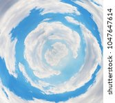 tiny planet of blue sky in... | Shutterstock . vector #1047647614