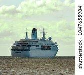 white cruise liner in riga city.... | Shutterstock . vector #1047655984