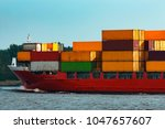red container ship. logistics...   Shutterstock . vector #1047657607
