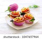 lentil stuffed eggplants. | Shutterstock . vector #1047657964