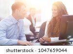 manager and employee discuss... | Shutterstock . vector #1047659044