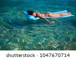 woman floating on air bed and... | Shutterstock . vector #1047670714