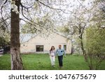 happy couple hold hands running ... | Shutterstock . vector #1047675679