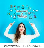 internet of things with young... | Shutterstock . vector #1047709621