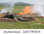 tanks buried in the ground are... | Shutterstock . vector #1047795574
