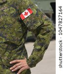 canada patch flag on soldiers... | Shutterstock . vector #1047827164