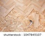 wooden floor installation | Shutterstock . vector #1047845107