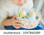 the little boy holds in his... | Shutterstock . vector #1047860389
