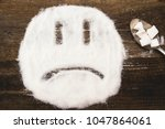 face of a sad smiley made with...   Shutterstock . vector #1047864061