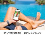 man by the pool looking at... | Shutterstock . vector #1047864109