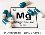 pills with mineral mg ... | Shutterstock . vector #1047873967