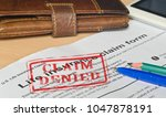 life insurance claim form on a... | Shutterstock . vector #1047878191