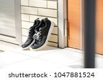 sneakers placed in front of the ... | Shutterstock . vector #1047881524