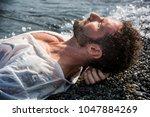 handsome muscular man on the... | Shutterstock . vector #1047884269