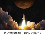 spacecraft takes off into space.... | Shutterstock . vector #1047890749