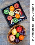 whole and sliced fruits of... | Shutterstock . vector #1047890845