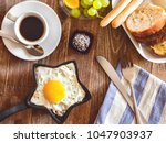fried eggs  fried on frying pan ... | Shutterstock . vector #1047903937