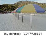 colorful sunshades on the beach | Shutterstock . vector #1047935839