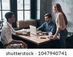 going over details. group of... | Shutterstock . vector #1047940741