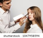 make up artist  young male  ... | Shutterstock . vector #1047958594