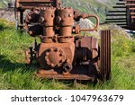 rusty engine on the lawns in... | Shutterstock . vector #1047963679