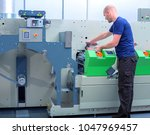 printer operator next to the... | Shutterstock . vector #1047969457