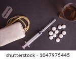 tablets  alcohol  rope or a... | Shutterstock . vector #1047975445