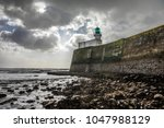 lighthouse of the little jetty... | Shutterstock . vector #1047988129