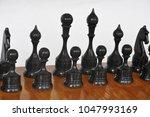chessmen on the board   Shutterstock . vector #1047993169