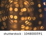 golden bokeh lights background | Shutterstock . vector #1048000591