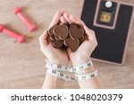 woman's tied hands with a... | Shutterstock . vector #1048020379