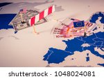 eu and usa trade war caused by... | Shutterstock . vector #1048024081