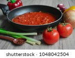 process of cooking hot tomato... | Shutterstock . vector #1048042504