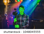 green grime face. young man... | Shutterstock . vector #1048045555