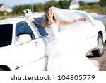 young bride standing beside a... | Shutterstock . vector #104805779