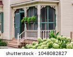 front porch of late 19th... | Shutterstock . vector #1048082827
